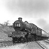 The Torbay Express is seen on 24 April 1953, a day later than the previous shot, in almost the same position at Southcote Junction.  Although the sun and exhaust are not quite so well defined, this time the locomotive is clearly identifiable as Castle class 5079 Lysander.