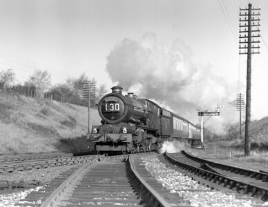 This quarter plate shot is undated.  From close examination of the original scan, it appears that the locomotive heading the Cornish Riviera is King Class 6024 King Edward I.  The picture must have been taken some time between February 1955, when the new bracket signal was installed and May 1956, when the Coley branch junction was relayed.