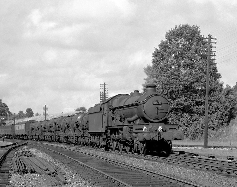 This milk train working seems to be a favourite topic.  Here 4077 Chepstow Castle passes Southcote Junction.  The shot must be after May 1956 as the realigned Coley branch is clearly visible.