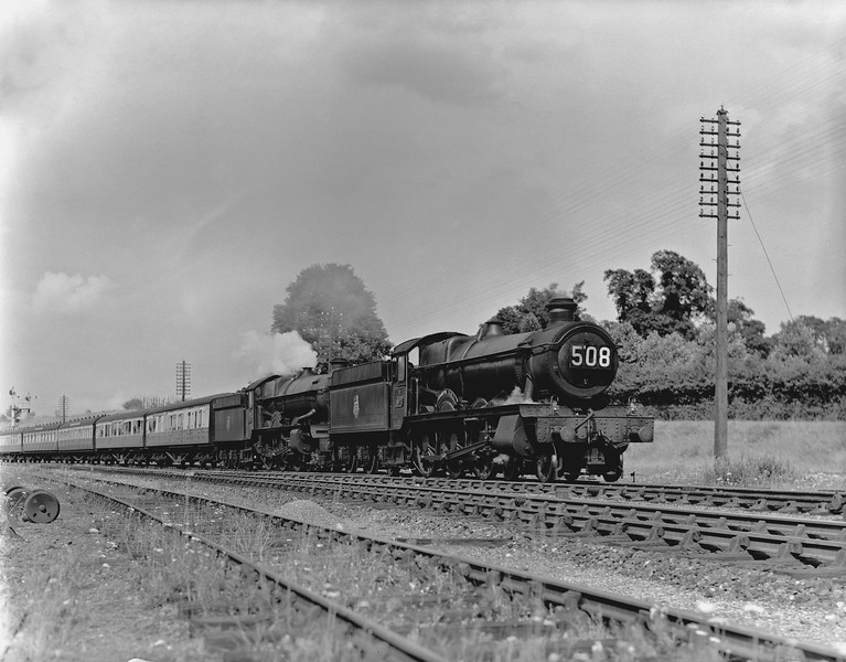 """One of the older (although undated) quarter plate shots from the collection. 4971 Stanway Hall heads an unidentified King on what is obviously a down West Country express (the notes indicate the 3.30pm ex-Paddington) through Southcote Junction. Ex-Paddington trains were supposed to carry train reporting numbers starting with """"1"""". Thanks to the work of Ed Chaplin on David Hey's web-site, I now know that """"508"""" should relate to a Minehead to Paddington train.  Clearly the reporting number has been left on the locomotive in error."""
