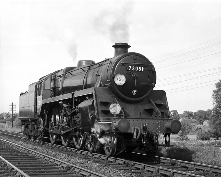 BR Standard Class 5 73051 pictured running light engine on the line from Reading to Basingstoke just past Southcote Junction.  This picture is from a volume of negatives dated 1957 to 1958.  This locomotive was given a new shed allocation code of 82F after February 1958 when the Western Region assumed responsibility for operations at Bath Green Park.  Therefore it is likely that the shot dates  from the summer of 1958.