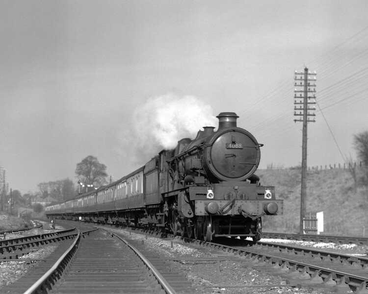 Another quarter plate negative.  This time 4088 Dartmouth Castle heads a train of BR Mk 1 coaches forming the 1.30pm ex-Paddington through Southcote on 5 March 1957.  Note the mechanical lubricating equipment on the locomotive.