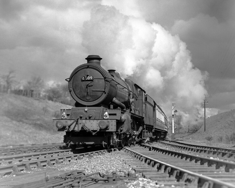 6009 King Charles II makes a dramatic impact in this quarter plate shot.  The train is the 11 am ex-Paddington and the date is 4 April 1953.