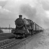 One of the very earliest quarter plate shots.  Although undated, I would expect it to be around 1952.  6990 Witherslack Hall heads a down express at a unspecified location but provisionally identified as near Twyford.