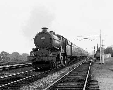 6017 King Edward IV approaches Tilehurst heading west on a very dull evening with just the very smallest hint of exhaust.  The picture is undated but is likely in 1956 or 1957.  6017 received its double chimney in December 1955.  It seems that the coaching stock for this train is mostly Collet in origin.