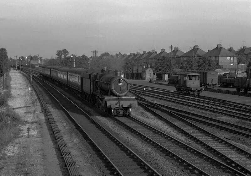 6852 Headbourne Grange in the evening sunshine approaching Tilehurst with a down stopping train.  This picture was taken from Tilehurst signal box in summer 1956.