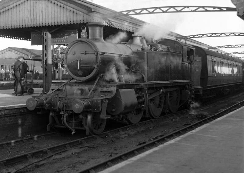 Taken in 1951, this is perhaps the best of the early shots.  An unidentified 61xx Prairie tank locomotive still sporting GWR lettering is seen awaiting departure from Reading General with a stopping train.