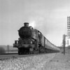 The notes to this quarter plate shot state that this is the 1.15 ex Paddington seen on the 4 March 1957.  The train is pictured near Basildon headed by Castle Class 5064 Bishop's Castle.