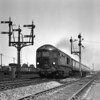 A Western Region curiosity, the Brown Boveri gas turbine locomotive 18000 passing Reading West Junction on a down express in the mid 1950s.
