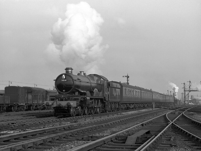 "5014 Goodrich Castle seen on the ""running in"" turn from Reading to Swindon on 12 October 1957 passing Reading MPD."
