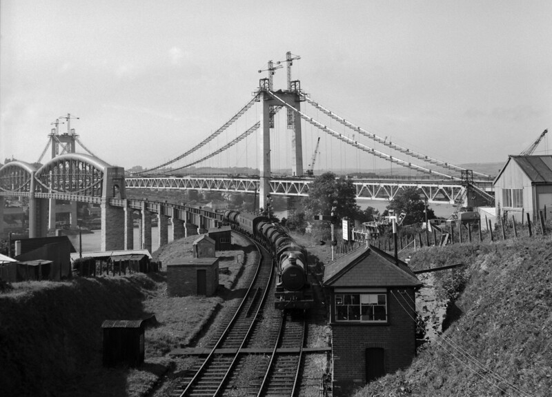 Having recently uploaded a picture from this point a few days ago, I came across this one taken by myself.  I include it because of the happy coincidence that the locomotive heading the milk train leaving the Royal Albert Bridge is 5069 Isambard Kingdom Brunel!  This photo was taken in summer 1961 with the Tamar road bridge under construction in the background.