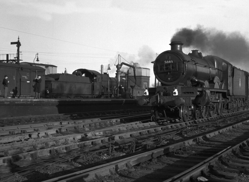 I have included this shot from 1951, not because it is a great work of art (which it is not!) but because it typifies the scene at Reading General in the 1950s.  The train spotters on the platform were almost a fixture in those days.  They watch as 5083 Bath Abbey approaches on a down express.  In the background, an unidentifiable Mogul waits to depart.