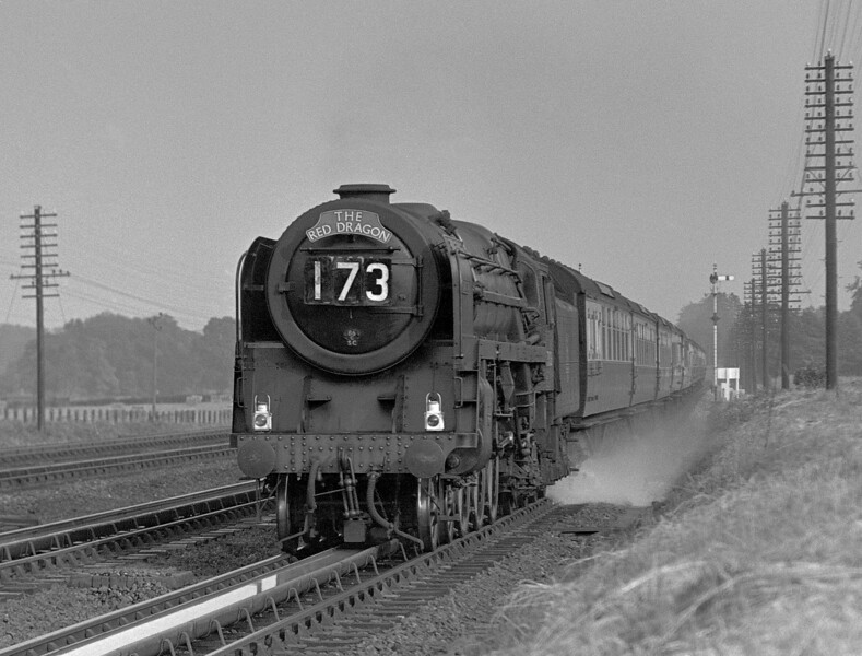 An unidentified Britannia heads the down Red Dragon past Goring troughs in the early 1950s, judging by the absence of the handholds in the smoke deflectors which were added after the Milton accident in October 1955.