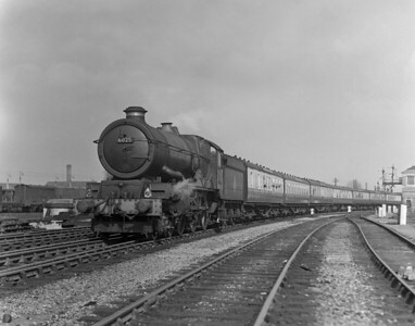 A quarter plate shot from the early 1950s shows King Class 6025 King Henry III heading a West Country bound express past Reading West Main signal box.