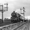 The dating of this quarter plate shot is uncertain but is likely around 1955.  An unidentified King is passing Reading West Junction at the head of The Bristolian:  the old style headboard helps to suggest the date.  Of most interest is the work gang standing back from the trackside.  They appear to have been working on the newly laid point rodding.