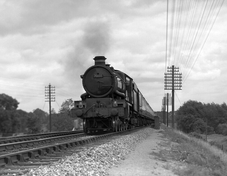 An early 1950s quarter plate shot (undated) of 7000 Viscount Portal heading an up express on the Berks and Hants line just west of Southcote Junction.