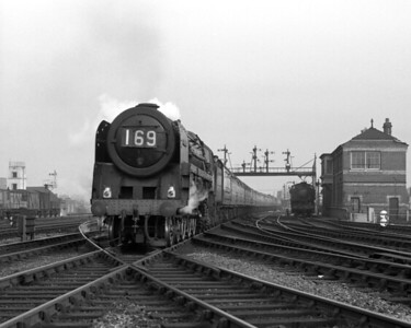 An unidentified Britannia Class pacific heads the 1.55 Paddington to Pembroke Dock past Reading West Main signal box.  The notes indicate that this shot was taken on 12 October 1957.