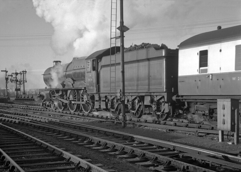 "6026 King John pulling out of Reading General with the 2.18pm service to Plymouth and Penzance on 1 December 1951.  ""For those of you watching in black and white"" (to coign a phrase!) the notes state that the locomotive was painted in B.R Blue livery!  This is another half frame shot on the Ensign 16/20 and I have to admit that it is not as sharp as my father would have wished.  But I just like the atmosphere."