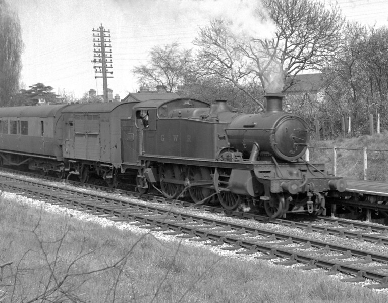 """6101 heading the 2.35pm local service to Newbury.  Photographed at Reading West Station on 24 April 1951.  The photograph was taken on an Ensign 16/20 using half frame.  In consequence a certain amount of """"grain"""" is in evidence."""