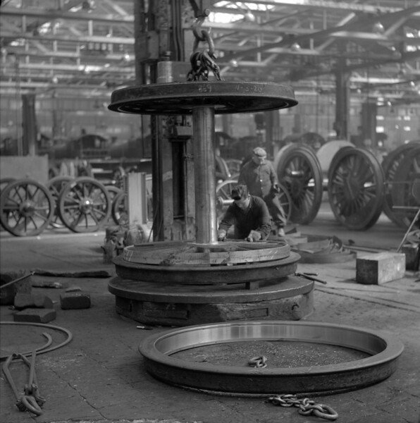 Inside 'A' Erecting Shop, a pair of driving wheels receives attention in April 1956.