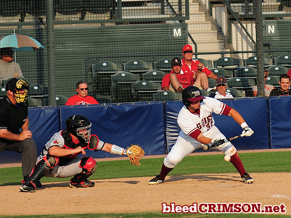 Robert Lecount (35) lays down a sacrifice bunt.<br /> <br /> Photo Credit: Sam Wasson