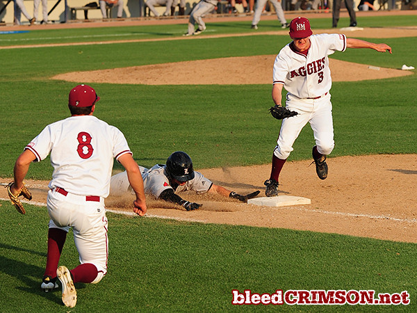 Robert Kraft (3) beats the runner to first for the third out of the seventh inning.<br /> <br /> Photo Credit: Sam Wasson