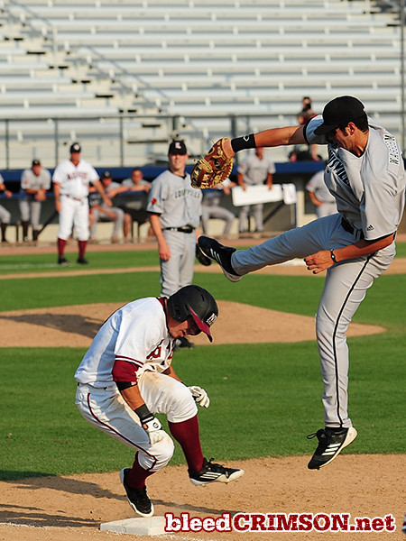 Zach Voight (11) is safe at first<br /> <br /> Photo Credit: Sam Wasson