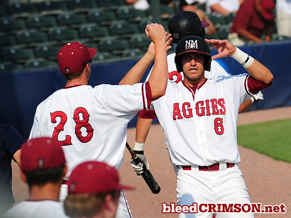 Parker Hipp (6) and Andy Lyon (28) celebrate the Aggies' first run of the game.<br /> <br /> Photo Credit: Sam Wasson