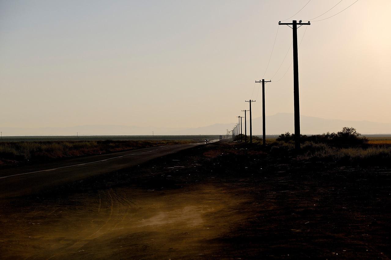 Sunset Dust Devil In Formation. I-5, Bakersfield, California