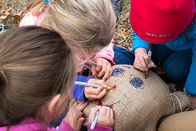 KELLY FLETCHER, REFORMER CORRESPONDENT -- Kids draw a face on the scarecrow they helped build as part of Newbrook Elementary School's Community Farm and Field Day on Friday, October 18th.