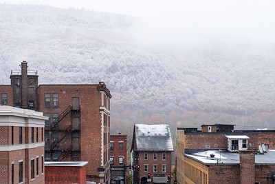 KELLY FLETCHER, REFORMER CORRESPONDENT -- A snowy Wantastiquet looms behind the rooftops of Brattleboro on Friday.
