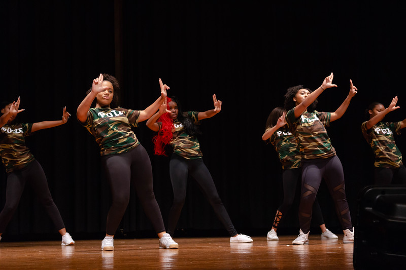 Poize, a hip hop team, performs a choreographed hip hop routine at Black Student Union Represent. BSU Represent was at 7 p.m., Oct. 27, at Forum Hall in the Union. (Mary Kate Zach   Collegian Media Group)