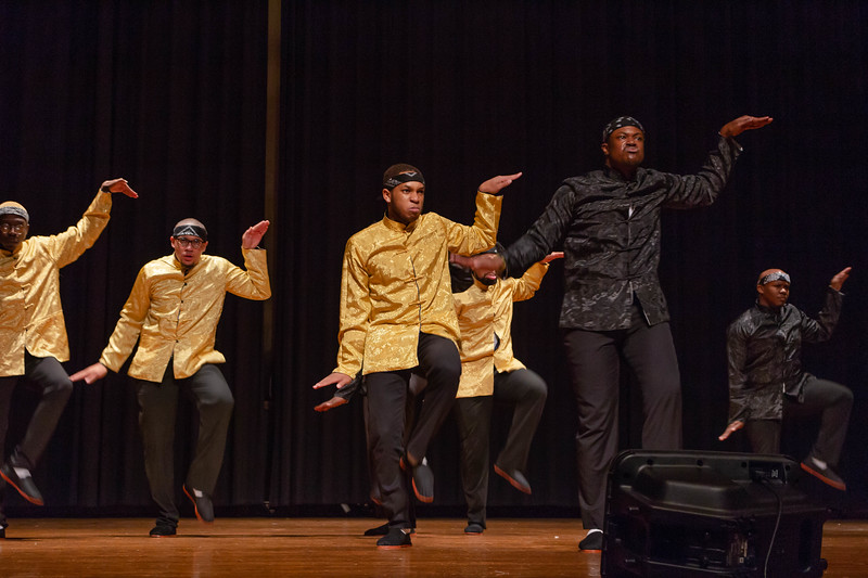"""Members of Alpha Phi Alpha Fraternity perform a step routine and maintain the """"grit face,"""" a staple of the Alphas, at Black Student Union Represent. BSU Represent was at 7 p.m., Oct. 27, at Forum Hall in the Union. (Mary Kate Zach   Collegian Media Group)"""