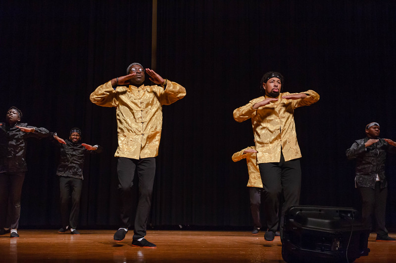 Alpha Phi Alpha performs a step routine with their main colors, black and gold, on at Black Student Union Represent. BSU Represent was at 7 p.m., Oct. 27, at Forum Hall in the Union. (Mary Kate Zach   Collegian Media Group)