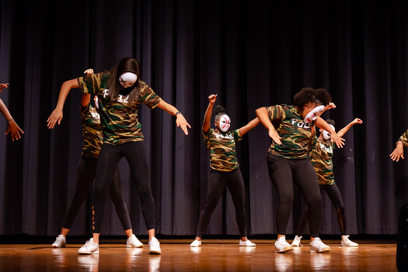 Poize, a hip hop team, performs a choreographed routine with masks on at Black Student Union Represent. BSU Represent was at 7 p.m., Oct. 27, at Forum Hall in the Union. (Mary Kate Zach   Collegian Media Group)