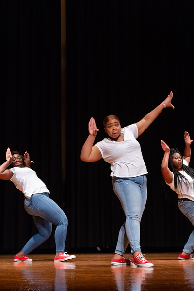 Members of Delta Sigma Theta lean back in sync as they perform their step routine at Black Student Union Represent. BSU Represent was at 7 p.m., Oct. 27, at Forum Hall in the Union. (Mary Kate Zach   Collegian Media Group)