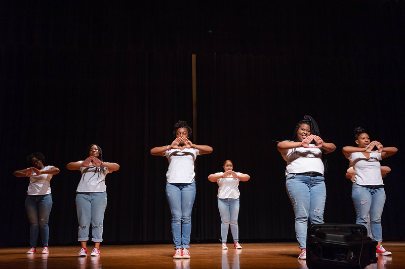 Members of Delta Sigma Theta Sorority hold up a Delta symbol to symbolize the letters of their sorority at Black Student Union Represent. BSU Represent was at 7 p.m., Oct. 27, at Forum Hall in the Union. (Mary Kate Zach   Collegian Media Group)