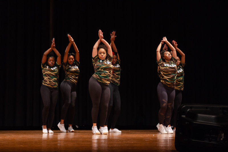 Poize, a hip hop team, moves in sync to the music during their performance at Black Student Union Represent. BSU Represent was at 7 p.m., Oct. 27, at Forum Hall in the Union. (Mary Kate Zach   Collegian Media Group)