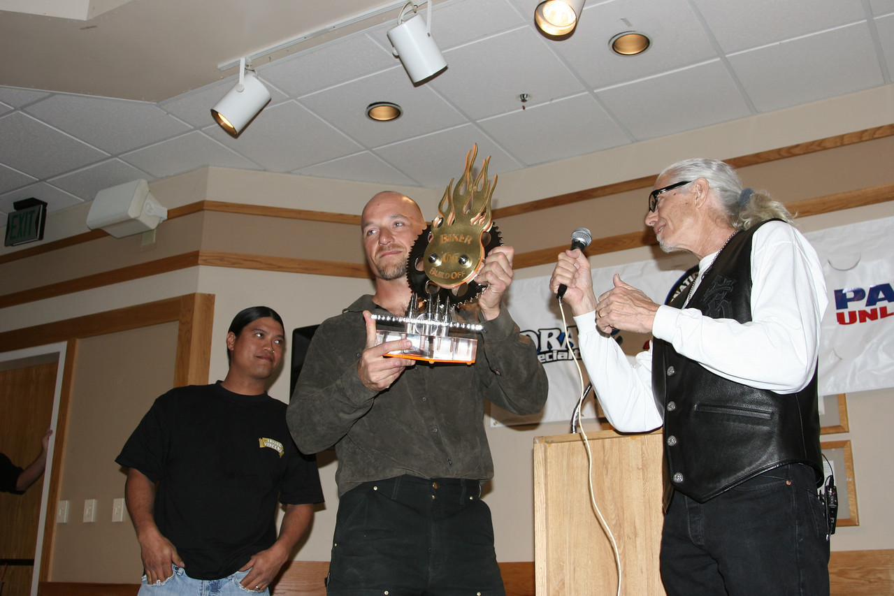 Roger Goldhammer wins the Biker Build Off and Hugh King the Chopper King presents the trophy