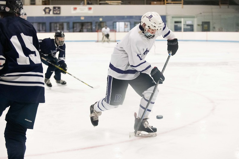 Brattleboro's Mason Foard maneuvers the puck towards the net during the second period of the Colonel's quarterfinal match up against Burlington Wednesday night at the Nelson Withington rink.