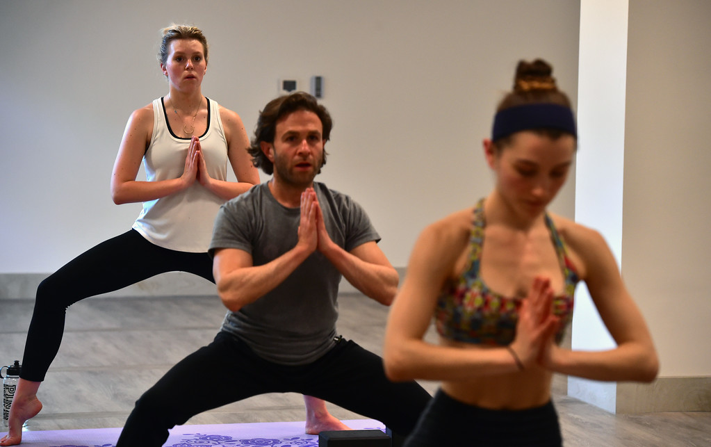 . From left to right McKenna Rohner, Shaun Kremin and Sophie Number in Bulldog Yoga\'s Invigorate class on Monday March 5. For more photos go to dailycamera.com. Paul Aiken Staff Photographer March 5 2018