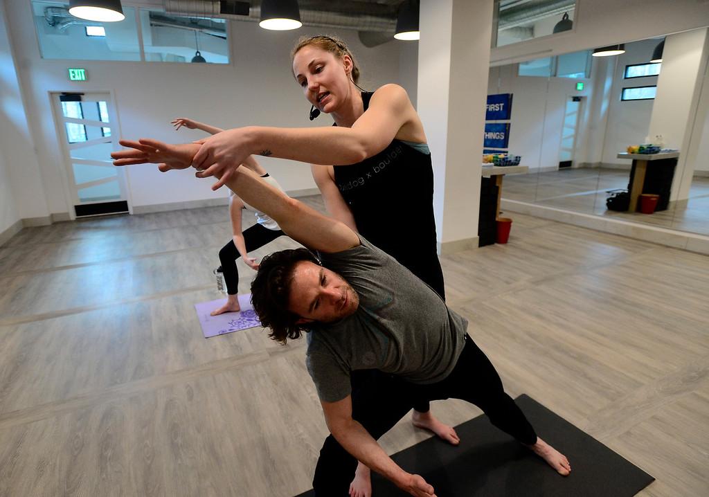 . Bulldog Yoga\'s Invigorate class on Monday March 5. For more photos go to dailycamera.com. Paul Aiken Staff Photographer March 5 2018