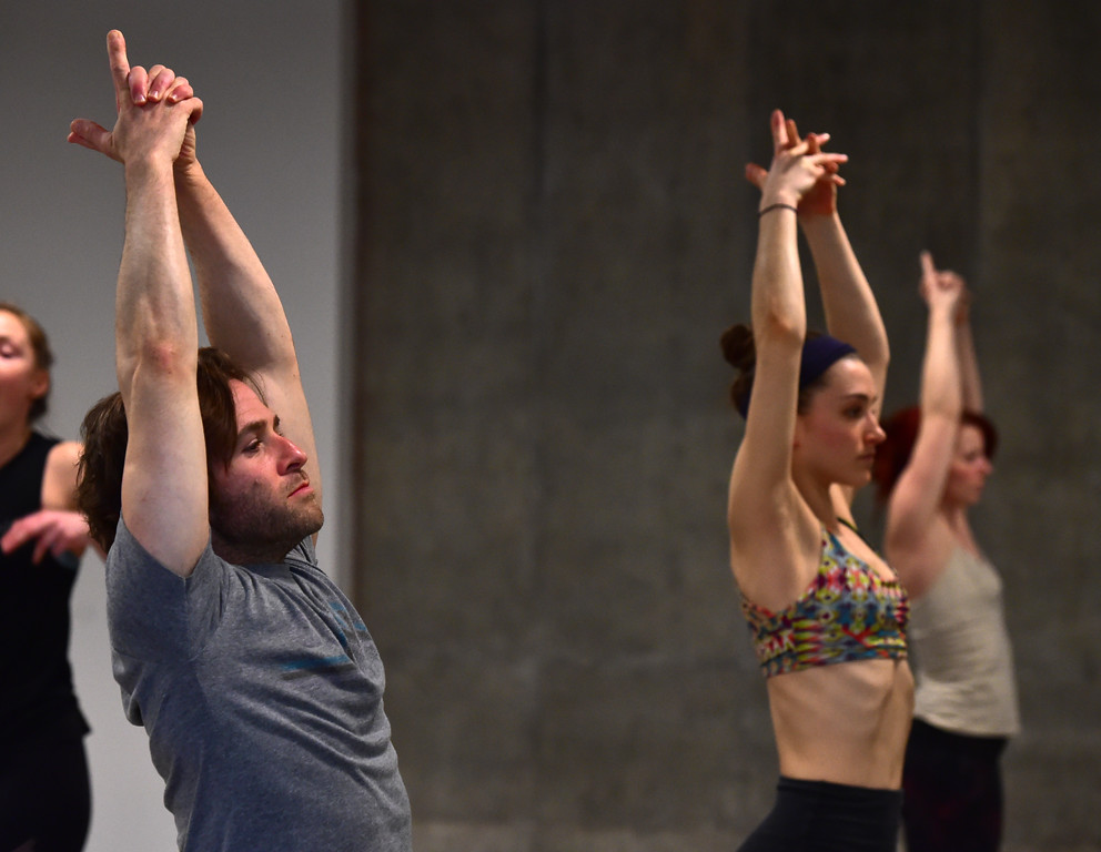 . Shaun Kremin and Sophie Numberg in Bulldog Yoga\'s Invigorate class on Monday March 5. For more photos go to dailycamera.com. Paul Aiken Staff Photographer March 5 2018