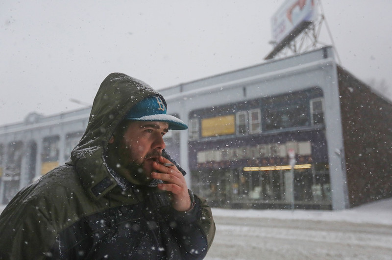 February 5, 2014 -Allston Resident Zac Galen walks to the bus as a snow storm hits Boston, Mass.. Photo: Grace Donnelly/BU News Service.