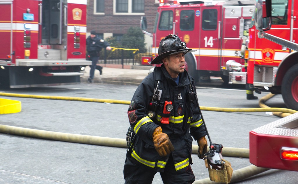 March 26, 2014 - A firefighter responds to a nine-alarm fire at 298 Beacon St.in Boston, Mass. Photo: Justin Saglio/BU News Service.
