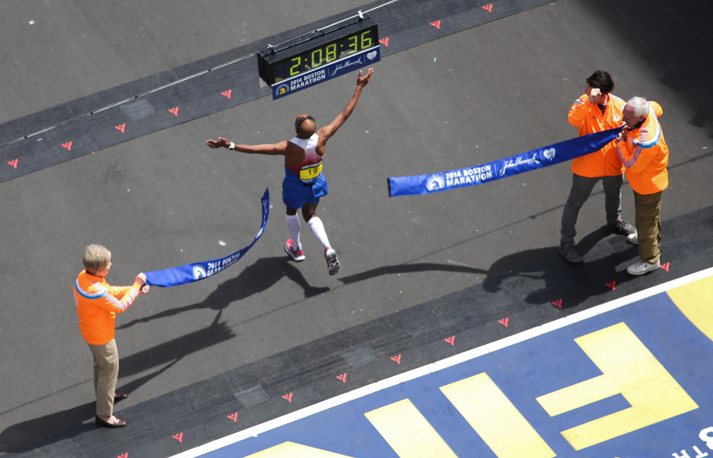 April 21, 2014 - Meb Keflegzhi crosses the finish line of the 118th Boston Marathon. Keflegzhi was the first man to cross the finish line, and the first American to win the marathon since 1983. Photo by Taylor Hartz/BU News Service.