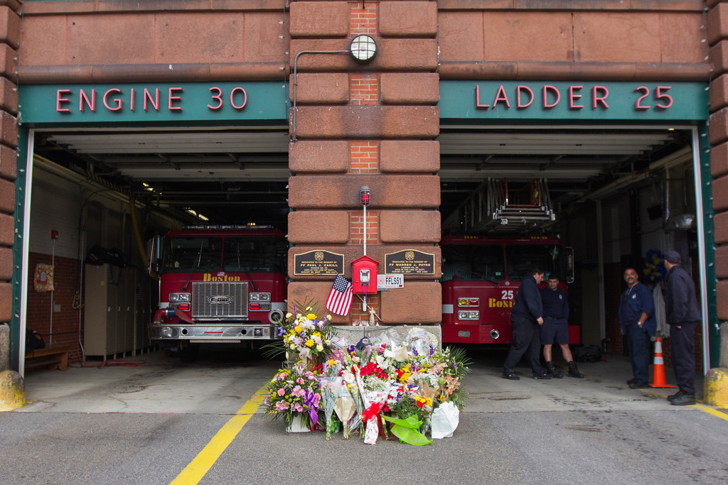 April 2, 2014 - Flowers are laid in front of the West Roxbury firehouse at 1940 Centre St., in Boston, Mass., in memory of Fire Lt. Edward Walsh Jr. and Firefighter Michael Kennedy who were killed while responding to a nine-alarm fire last week. Photo by Jun Tsuboike/BU News Service.