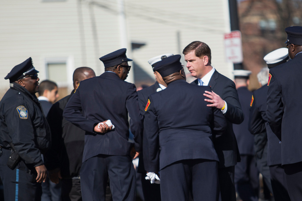 April 2, 2014 – Boston Mayor Marty Walsh interacts with Boston police officers outside the the P.E. Murray Funeral Home at 2000 Centre St., in Boston, Mass., at the wake for Firefighter Michael Kennedy who was killed while responding to a nine-alarm fire last week. Photo by Jun Tsuboike/BU News Service.