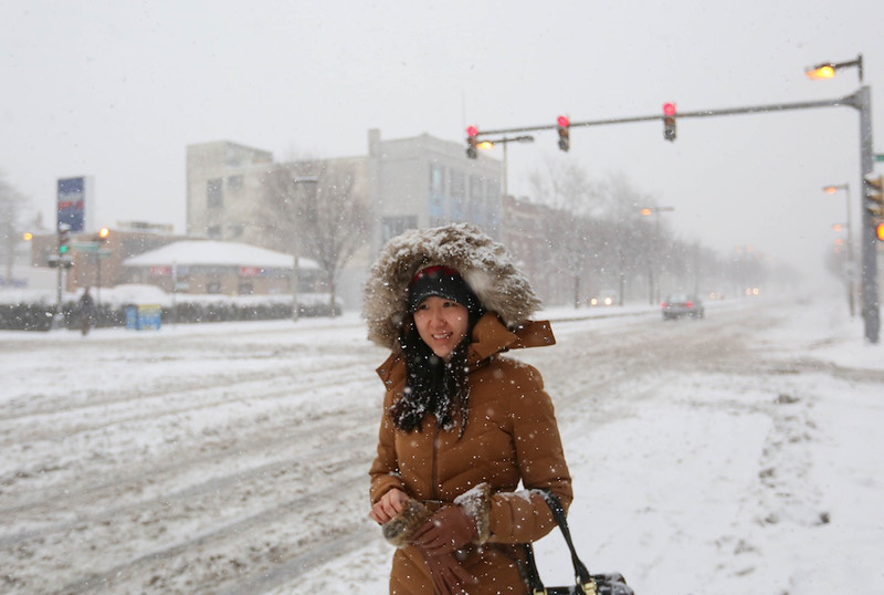 February 5, 2014 - Allston resident Anna An waits for the MBTA 57 Bus on Brighton Ave. in Allston, Mass. during a winter storm.  Photo by Grace Donnelly/BU News Service.