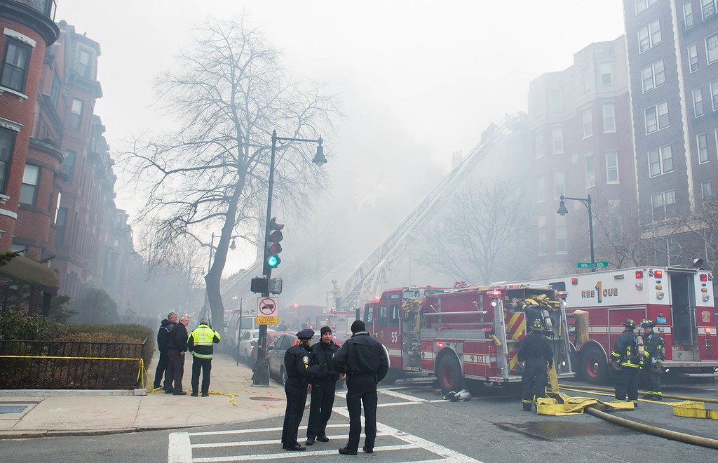 March 26, 2014 - Firefighters respond to a nine-alarm fire at 298 Beacon St. in Boston, Mass. Photo: Justin Saglio/BU News Service.